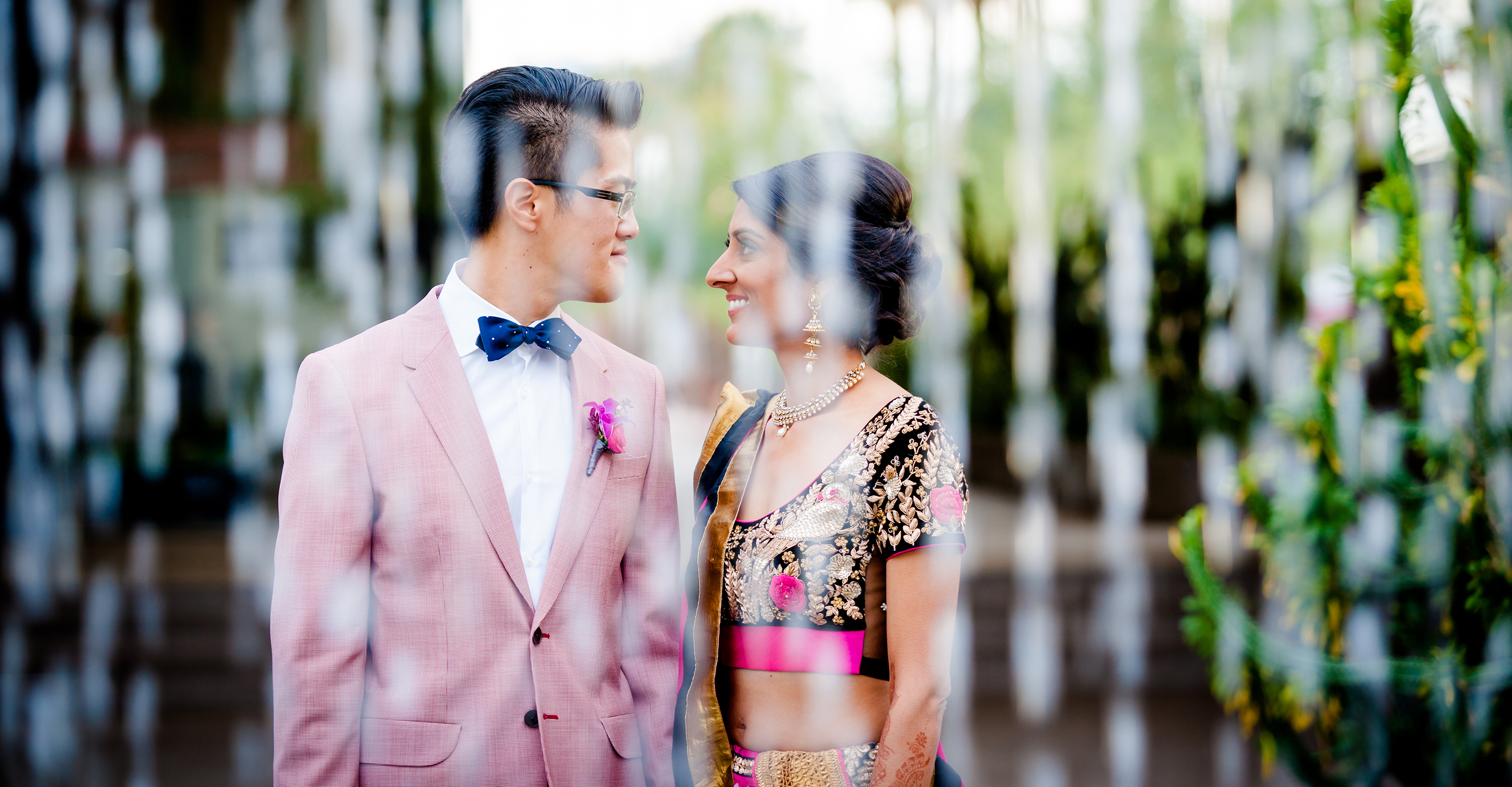 Multicultural wedding in Phoenix Art Museum. Indian bride and Chinese groom